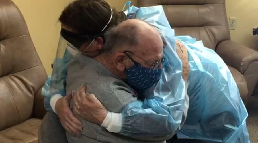 Simple hug becomes powerful embrace during reunion