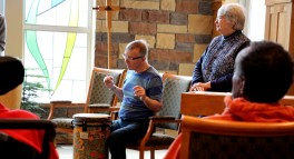 Fred is playing the drums which soothe his struggle with Huntington's disease.
