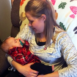 Home health RN case manager LaToya Buzalsky holds baby Murphy.